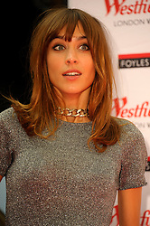 Image ©Licensed to i-Images Picture Agency. 12/08/2014. London, United Kingdom. Alexa Chung, model, TV presenter and style icon signs copies of her bestselling book, 'IT' which combines her writing with personal drawings, sketches and photographs. Picture by Chris Joseph / i-Images