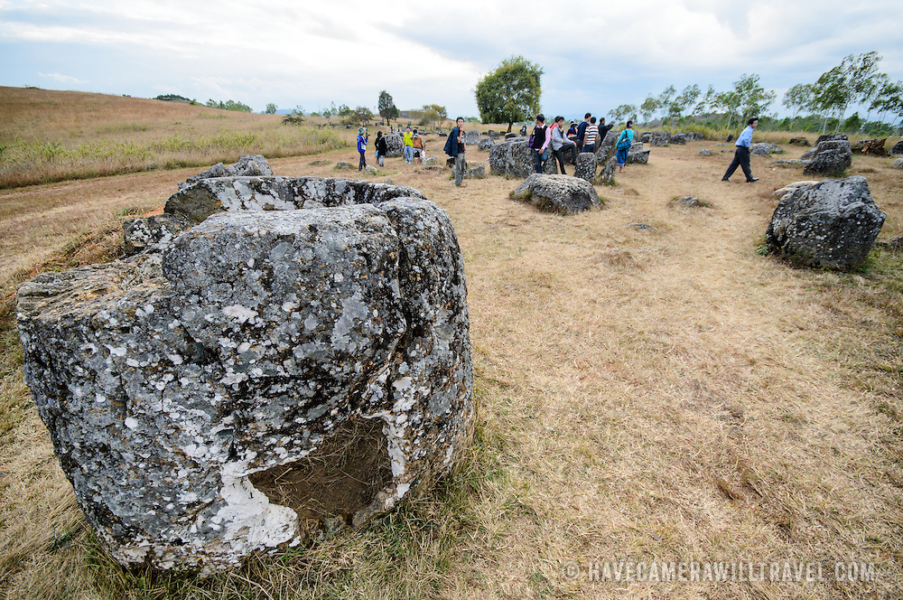 Some of the mysterious stone jars at Site 1 of the Plain of Jars in north-central Laos. Much remains unknown about the age and purpose of the thousands of stone jars clustered in the region. Most accounts date them to at least a couple of thousand years ago and theories have been put forward that they were used in burial rituals.