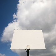 A backboard without a hoop is seen at the basketball court at Jamie Farr Park in Toledo on Thursday, April 16, 2020. Hoops have been removed from basketball courts locally and nationally in response to the COVID-19 pandemic to dissuade people from congregating to play basketball. THE BLADE/KURT STEISS