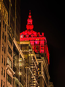 The Helmsley Building lit up in red color in Manhattan, New York City.
