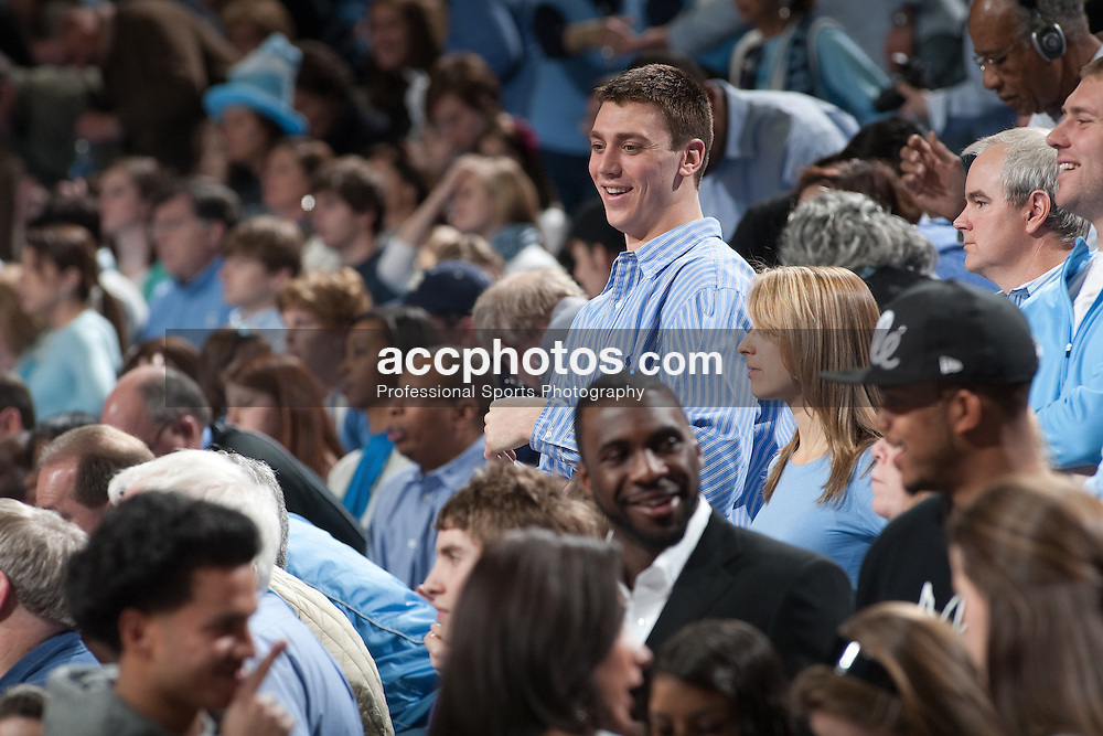 13 February 2010: During the 100th anniversary celebration, alumni players of North Carolina basketball gather at the Dean E. Smith Center in Chapel Hill, NC.  Pictured here is former player Tyler Hansbrough (blue, button-up shirt).