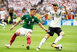June 17, 2018 - Moscow, Russia - 180617 Carlos Salcedo of Mexico and Mesut Özil of Germany during the FIFA World Cup group stage match between Germany and Mexico on June 17, 2018 in Moscow..Photo: Petter Arvidson / BILDBYRÃ…N / kod PA / 92069 (Credit Image: © Petter Arvidson/Bildbyran via ZUMA Press)
