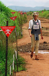 Diana, Princess of Wales, touring a minefield in body armour to see for herself the carnage mines cause, during her visit to Angola.