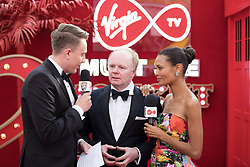 EDITORIAL USE ONLY<br /> (left to right) Jason Watkins and Thandie Newton spill the beans to Virgin TV's red-carpet host Roman Kemp in Virgin TV's Must-See Moment Lounge at the Virgin TV British Academy Television Awards.