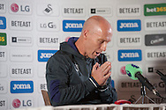 Bob Bradley appears to pray as he is officially announced as the new Swansea city manager at a press conference at the Marriott Hotel in Swansea, South Wales on Friday 7th October 2016.  pic by Phil Rees, Andrew Orchard sports photography