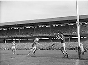 Kerry hits the ball hard towards the goal during the All Ireland Senior Gaelic Football Championship Final, Kerry vs Galway in Croke Park on the 27th September 1959. Kerry 3-7 Galway 1-4. Alied Irish Bank Ansley Bridge Poplar Rd, Fairview North Srand, East Wall Rd Houses, Shiriff St Church Clouds Howth Cornmarket, St Brendans March 1987