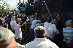October 3, 2016 - Athens, Greece - Demonstrators press a riot police van in order to pass through..Greek pensioners demonstrate in Athens against the goverment cuts on pensions and their benefits in General. Demonstrators clashed with riot policve after they found the road to Prime Ministers office closed by police. (Credit Image: © George Panagakis/Pacific Press via ZUMA Wire)
