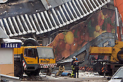 Moscow, Russia, 23/02/2006..Emergency workers in front of the remains of Baumanskii Marrket in eastern Moscow after the market roof collapsed, apparently under the weight of snow, killing many people.