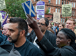 Pictured: Protesters carried placards calling on SERCO and the Home Office to change their policy.<br /> <br /> Protesters gathered outside the main Home Office building in Glasgow to protest at private company SERCO's attempts to evict failed asylum seekers from their homes.<br /> <br /> © Dave Johnston / EEm