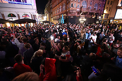 © Licensed to London News Pictures. 07/07/2021. London, UK. England fans celebrating fill the streets surrounding Leicester Square in central London after England beat Denmark in the Euro 2020 semi final, to reach their first final since 1966. Photo credit: Ben Cawthra/LNP