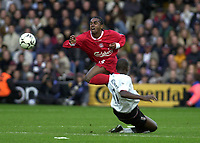 Picture: Henry Browne.<br />Date: 02/11/2003.<br />Fulham v Liverpool  FA Barclaycard Premiership.<br />Luis Boa Morte is sent off for this challenge on Liverpool's Florent Sinema - Pongolle