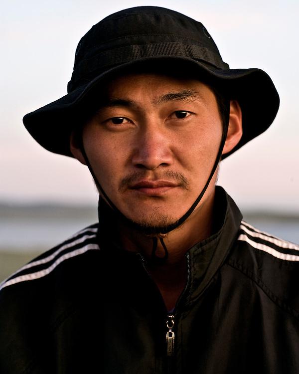 Portraits of Mongolian Man wearing a Hat