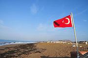 Turkey, Antalya, Turkish flag on the beach