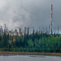 An oil refinery hides in a forest beside the Yellowtail Highway west of Edmonton, Alberta.