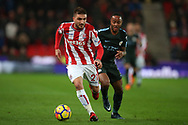 Kostas Stafylidis of Stoke City (l)  holds off Raheem Sterling of Manchester City. Premier league match, Stoke City v Manchester City at the Bet365 Stadium in Stoke on Trent, Staffs on Monday 12th March 2018.<br /> pic by Andrew Orchard, Andrew Orchard sports photography.