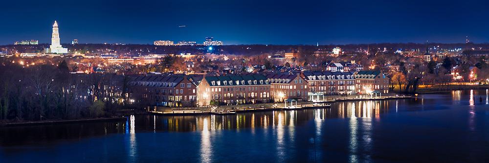 A full moon overhead illuminates the Potomac River and city of Alexandria, VA. As seen from the Woodrow Wilson Bridge.