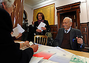 "© Licensed to London News Pictures. 02/02/2012, Kingston Upon Thames, UK. 104 year-old becomes Britain's oldest new citizen. Officials check Mr Khanjar's paperwork is in order. 104 year-old TAUFEEK KHANJAR became a British Citizen at a ceremony held by Surrey County Council today (01 February 2012). Mr Khanjar is originally from Iraq and worked as a jewellery maker in Baghdad. He came to the UK six years ago to live with his daughter Nada Dabis, 59, in South Cheam, Surrey, where he enjoys walking, feeding the birds, playing cards and listening to music. He is a widower with four sons and two daughters. Durning the ceremony Mr Khanjar took an oath to the Queen, pledging that he will be a faithful citizen and obey the laws of the country. He explained the secret to a long and healthy life was to ""never get stressed and be relaxed"".  Photo credit : Stephen Simpson/LNP"