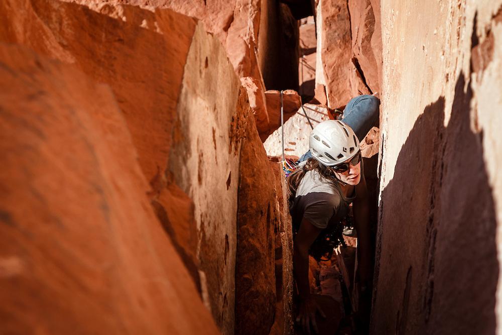 Julia Geisler climbs the first pitch of Kor Ingalls, 5.10, Castle Valley, Utah.