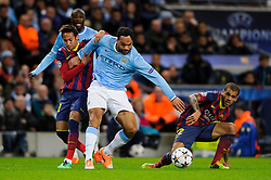 Man City Defender Joleon Lescott (ENG) is challenged by Barcelona Forward Neymar (BRA) and Defender Daniel Alves (BRA) - Photo mandatory by-line: Rogan Thomson/JMP - Tel: 07966 386802 - 18/02/2014 - SPORT - FOOTBALL - Etihad Stadium, Manchester - Manchester City v Barcelona - UEFA Champions League, Round of 16, First leg.