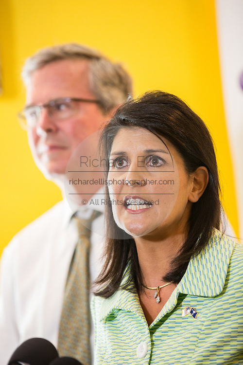South Carolina Governor Nikki Haley speaks to reporters with Former Florida Governor and GOP presidential candidate Jeb Bush during a visit to Sistercare March 17 29, 2015 in Columbia, South Carolina. Bush joined Haley in visiting the center for victims of domestic violence.