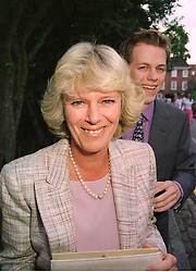 MR TOM PARKER BOWLES and his mother MRS CAMILLA PARKER BOWLES, at a party in London on 25th June 1998.MIT 186