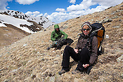 Kate Clark, Brian Bernhardt and their dog Zapata relax in the alpine above Parika Lake, Never Summer Wilderness, Colorado.