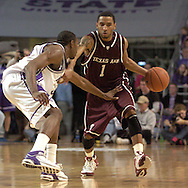 Texas A&M guard Acie Law (1) brings the ball up court against pressure from Kansas State's Akeem Wright (L) during K-State's 58-54 win over the Aggies at Bramlage Coliseum in Manhattan, Kansas, January 18, 2006.