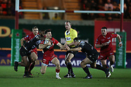Gareth Davies of Scarlets makes a break in the 2nd half but is stopped by a high tackle around his neck from Toulon's  Semi Radradra Turagasoli Waqavatu (l)  .  EPCR European Champions cup match, Scarlets v RC Toulon at the Parc y Scarlets in Llanelli, West Wales on Saturday 20th January 2018. <br /> pic by  Andrew Orchard, Andrew Orchard sports photography.