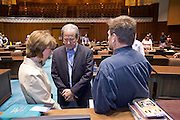 07 MAY 2009 -- PHOENIX, AZ: Cheryl Sacks (CQ), her husband Hal. H. Sacks (CQ) and Guy Chadwick (CQ) pray in the House of Representatives chambers during the National Day or Prayer services at the State Capitol in Phoenix Thursday. About 30 people came to the capitol to pray for government officials at the desks of legislators.  Photo by Jack Kurtz