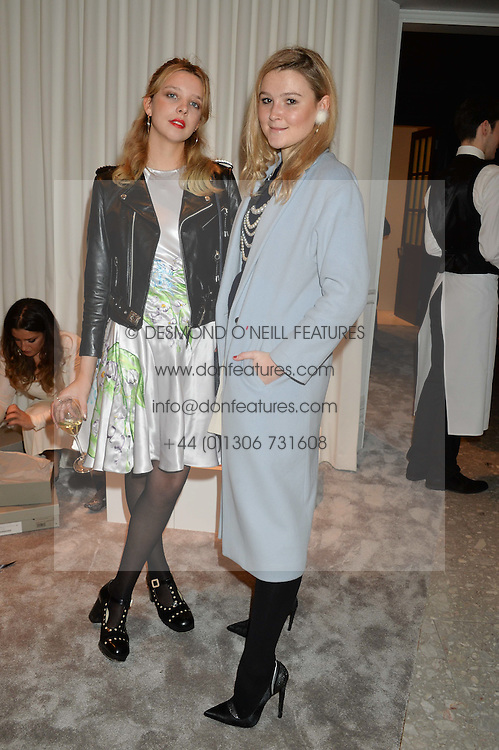 Left to right, GRETA BELLAMACINA and AMBER ATHERTON at the Crisian London Boutique Opening at 41-42 Dover Street, London on 18th November 2014.