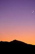 Crescent moon and evening light over the San Francisco Peaks, Arizona