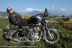 Round the World Doug Wothke poses with a spectacular background of 23,000' peaks on day-4 our our Himalayan Heroes adventure riding from Pokhara to Kalopani, Nepal. Friday, November 9, 2018. Photography ©2018 Michael Lichter.