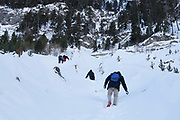 Migrants walk through snow on a steep ravine as they attempt to cross a part of the mountain range of the Alps from Italy into France, near the town of Bardonecchia in northern Italy.