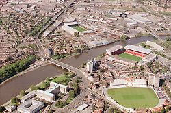 Aerial view of Trent Bridge with County Hall in the left foreground,  Nottinghamshire County cricket ground on the right with Nottingham Forest football ground behind; Notts County ground is also visible across the river,