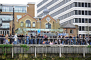Putney, London,  Crowds of spectators enjoying the afternoon waiting for the star of the 156th University Boat Race  over  the Championship Course,  Putney to Mortlake. on Saturday  03/04/2010 [Mandatory Credit Peter Spurrier/ Intersport Images]