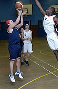 Tigers' Ornella gets the shot away despite pressure from Erks' Martin Overare on Thursday 9th February. This was Tigers' last home game at the Dawson Avenue gym since the School was closing the following day.