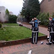 Brand in woning Berlagestraat, brandweer perslucht