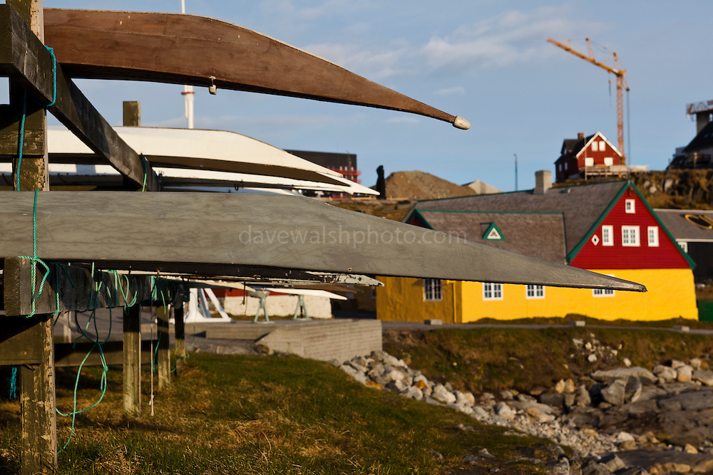 Kayaks on a rack at the old harbour, Nuuk, Greenland. Copyright 2009 Dave Walsh