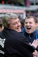 Photo: Glyn Thomas.<br />Birmingham City v Wigan Athletic. The Barclays Premiership. 02/01/2006.<br />Steve Bruce (L) shares a joke with Paul Jewell before kick off.
