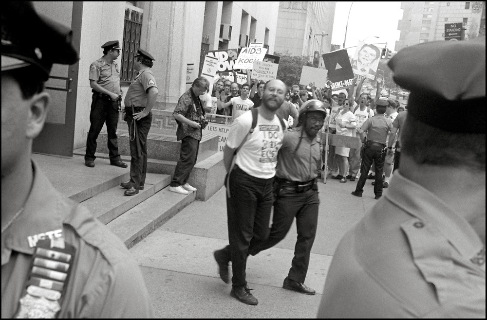 Richard Deagle was arrested after several ACT UP members staged a sit-in in the offices of Stephen Joseph, the New York City Commissioner of Health, as others demonstrated outside, after Joseph had suddenly halved the number of estimated AIDS cases in NYC, on July 19th, 1988 - a move that threatened to drastically reduce funding for AIDS services.