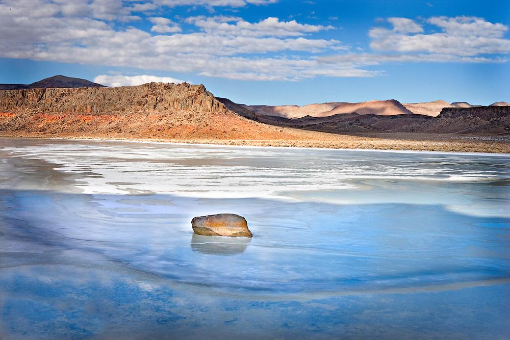 Red Rock in Frozen Winter Pond, Central Nevada