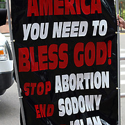 The Bible Believers signage as seen during the Republican National Convention in Tampa, Fla. on Wednesday, August 29, 2012. (AP Photo/Alex Menendez)