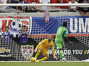 JACKSONVILLE, FL - JUNE 07:  Forward Victor Moses #11 of Nigeria shoots a penalty kick and scores while goalie Tim Howard #1 of the United States leans the other way during the international friendly match at EverBank Field on June 7, 2014 in Jacksonville, Florida.  (Photo by Mike Zarrilli/Getty Images)