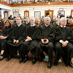 Texas Supreme Court Justice Eva Guzman (far left) is shown at the State of the Judiciary ceremony at the Texas Capitol on March 6, 2013.   Guzman, the first Hispanic woman to serve on the Texas Supreme Court, resigned her position and is rumored to be considering a challenge to Attorney General Ken Paxton.