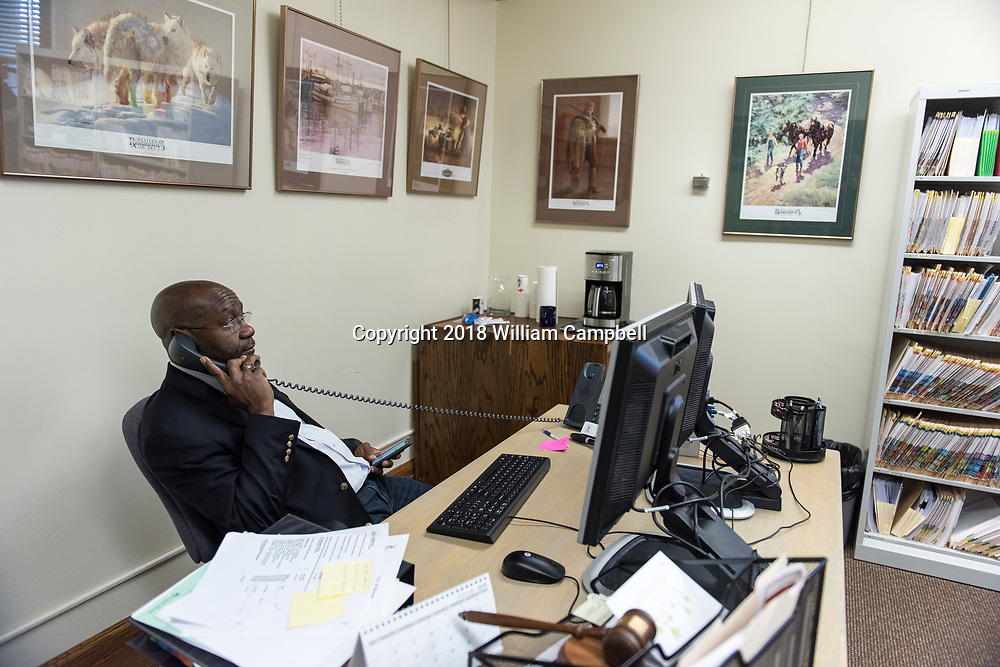 HELENA,MT-JANUARY 31-Wilmot Collins, the newly elected Mayor of Helena, Montana in his desk during his first month in office.<br /> <br /> Wilmot Collins, 54, is a former Liberian refugee who recently defeated a four-term incumbent to become Mayor of Helena, Montana, the state's capital city. Collins is Montana's first elected black mayor since statehood. Mayor Collins arrived in the United States in 1994 as a refugee from the brutal Liberian civil war, joining his wife, Maddie, a medical student who arrived ahead of him. Mr. Collins became a United States citizen in 2001. He has served in the US military for 22 years in the Army, Army Reserve, and currently Navy Reserve. Mr. Collins is a child protection specialist with the Montana Department of Child and Family Services and an adjunct professor at the Helena College of the University of Montana.