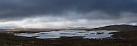 Mountain lake with distant mountains in clouds, near Tärnasjös hut, Kungsleden trail, Lapland, Sweden