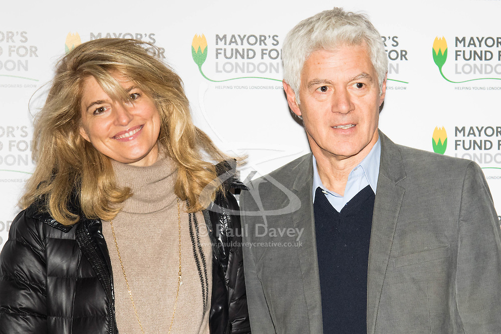 Halcyon Gallery, London, November 24th 2015. Mayor of London Boris Johnson joins celebrities and business leaders at Mayfair's Halcyon Gallery where pictures from a book showcasing London's true colours will be sold to raise money for the Mayor's Fund For London, which helps disadvantaged youths gain a foothold on the employment ladder. PICTURED: Celebrity hairstylist John Frieda with partner Avery Agnelli