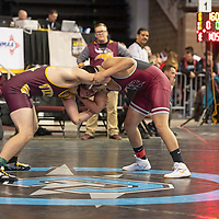 Valley Viking Ricky Henderson, left, wrestles Shiprock Chieftain Winston Mike in the first round of the New Mexico Activities Association State Wrestling Championships Friday morning at the Santa Ana Star Center in Rio Rancho.
