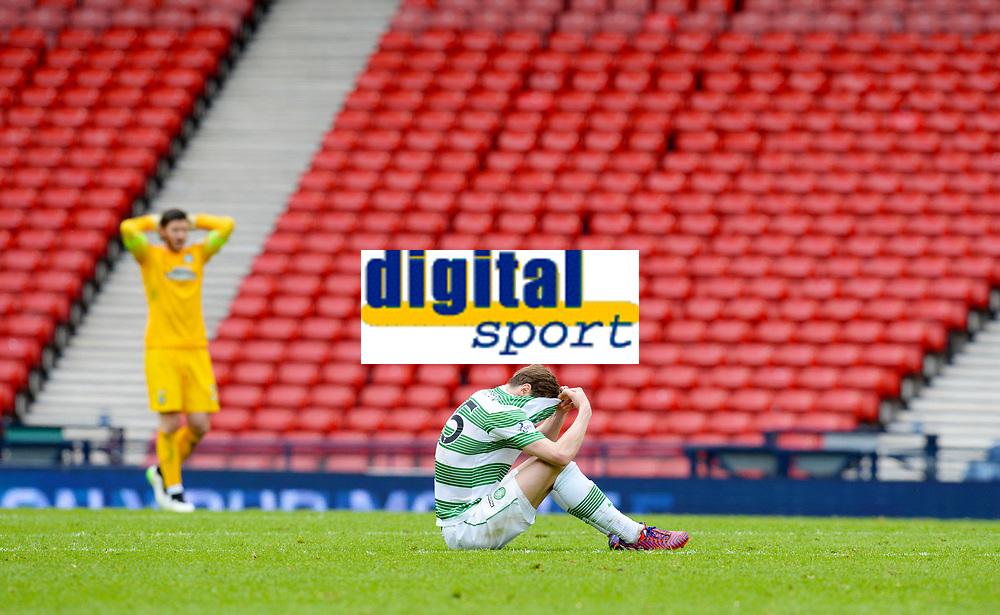 19/04/15 WILLIAM HILL SCOTTISH CUP SEMI-FINAL<br /> INVERNESS CT v CELTIC<br /> HAMPDEN - GLASGOW<br /> Dejection for Celtic's Stefan Johansen at full-time