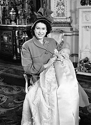 File photo dated 15/12/48 of Princess Elizabeth holding Prince Charles after his christening ceremony at Buckingham Palace. The Duke and Duchess of Sussex's baby son Archie is expected to be baptised in the royal christening gown.